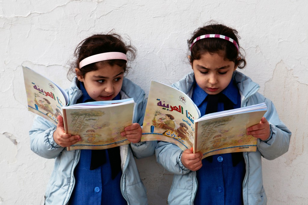 (2011_Education_for_All_Global_Monitoring_Report)_-Government_primary_school_in_Amman,_Jordan_-_Young_girls_reading