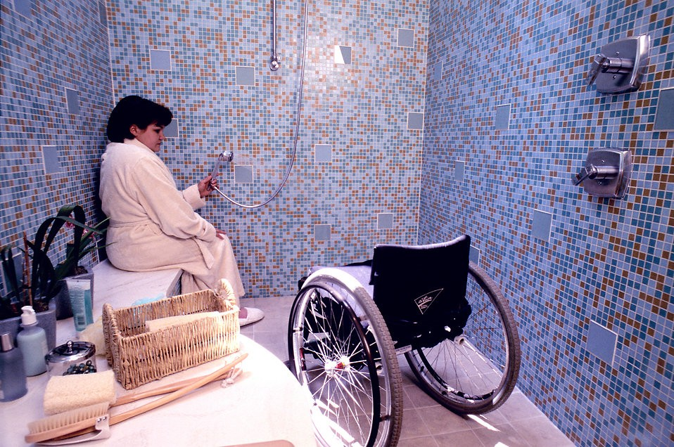 16769-a-woman-in-a-wheelchair-getting-into-a-shower-pv