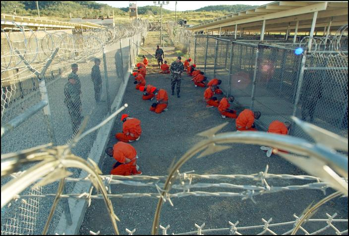 Guantanamo_captives_wait_during_processing_on_January_11th,_2002