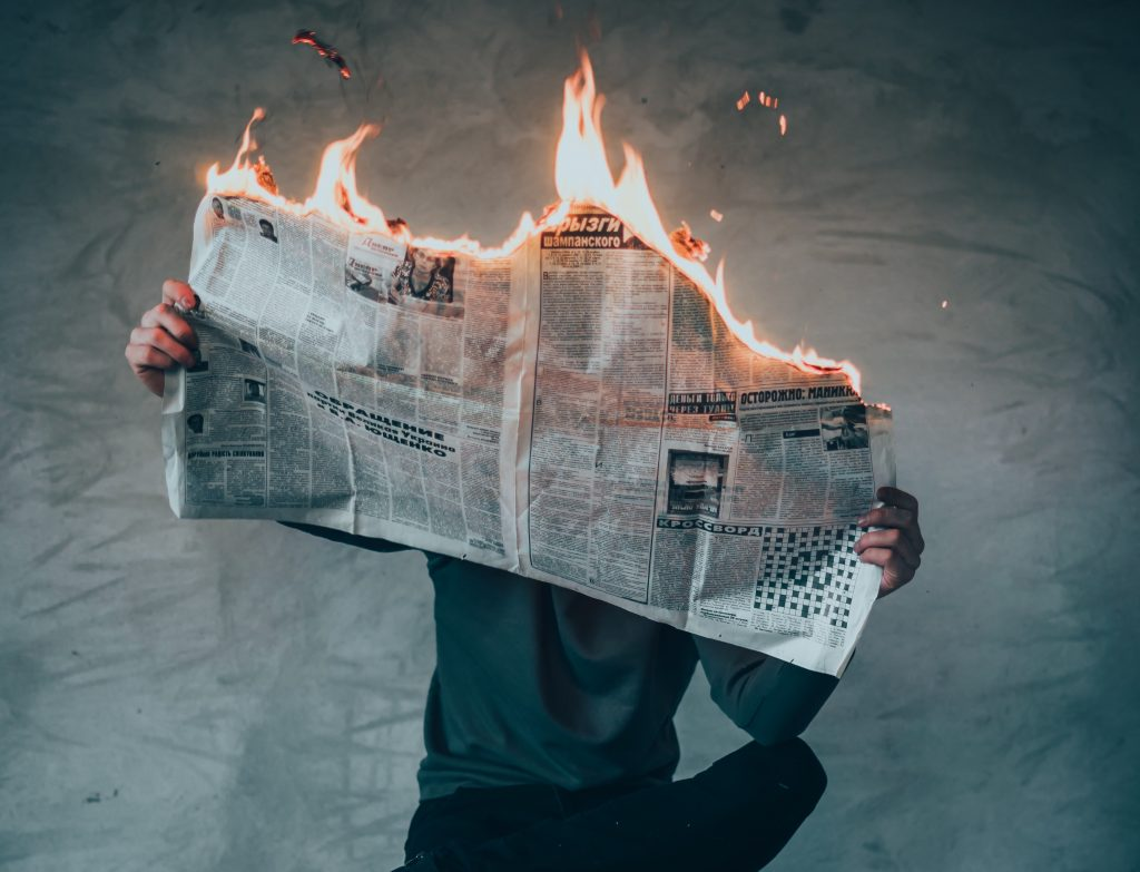 newspaper on fire freedom of the press