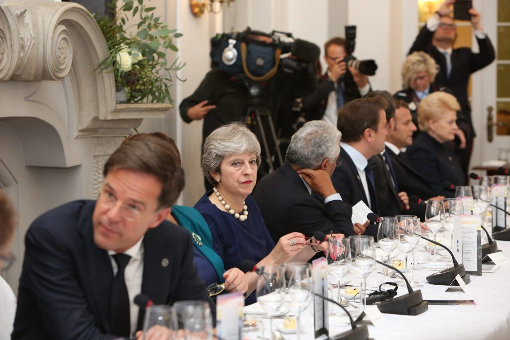 Theresa May sat at a table with other world leaders