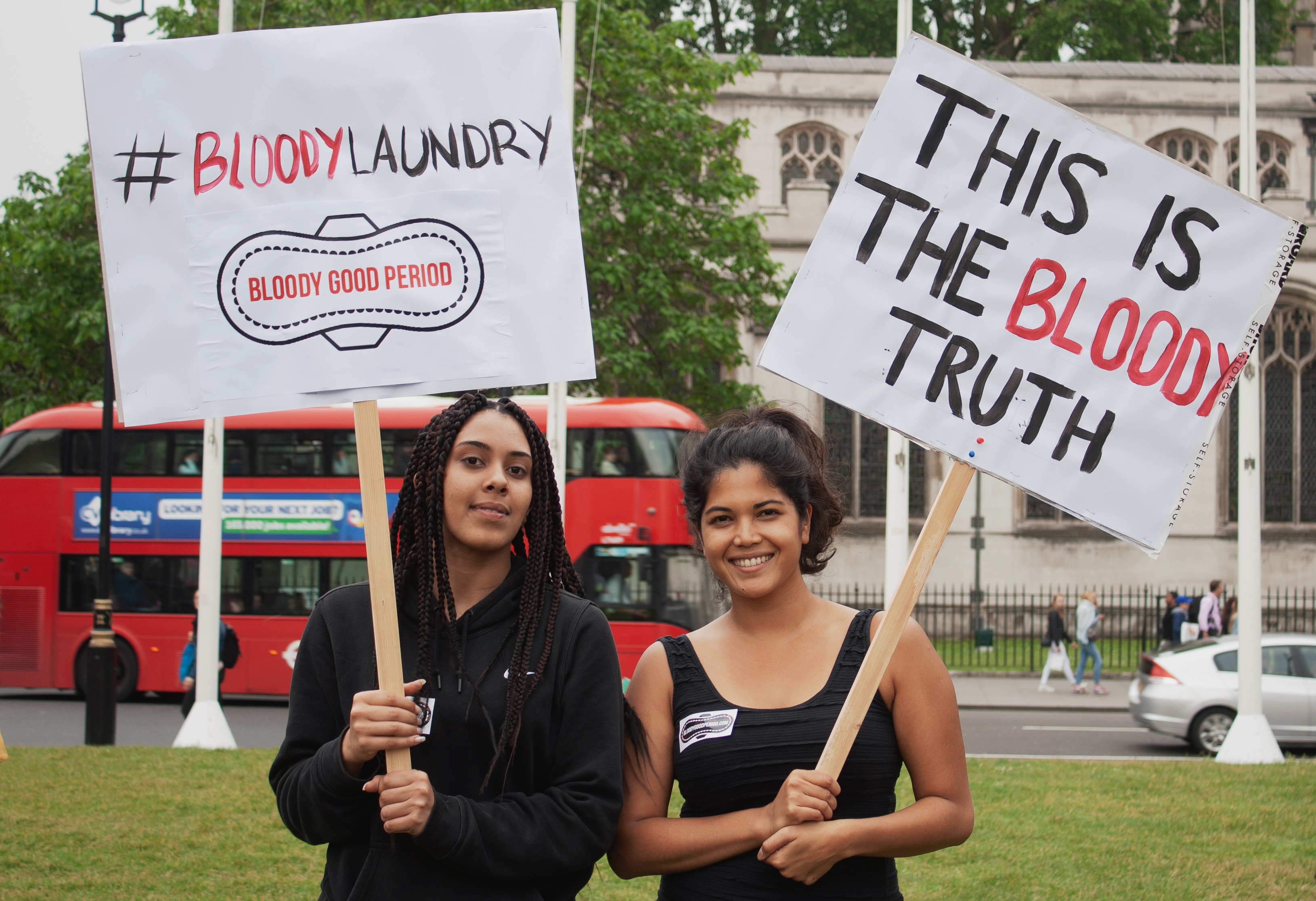 period poverty campaigners with signs