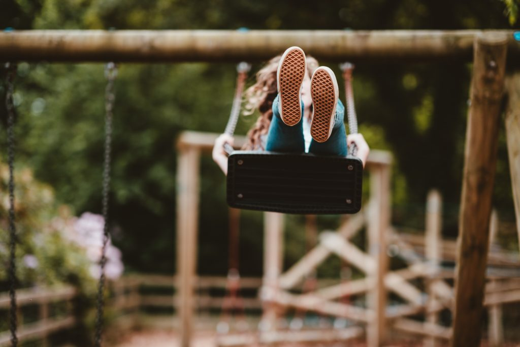 a girl on a swing, to highlight the importance of the right to play