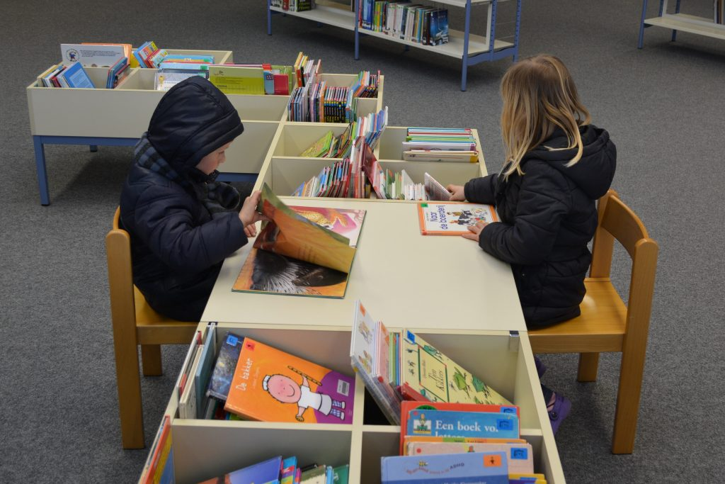 Children reading in a library to illustrate a schoolgirl challenging Northamptonshire County Council's proposal to shut 21 out of 36 libraries (Aug 15, 2018)