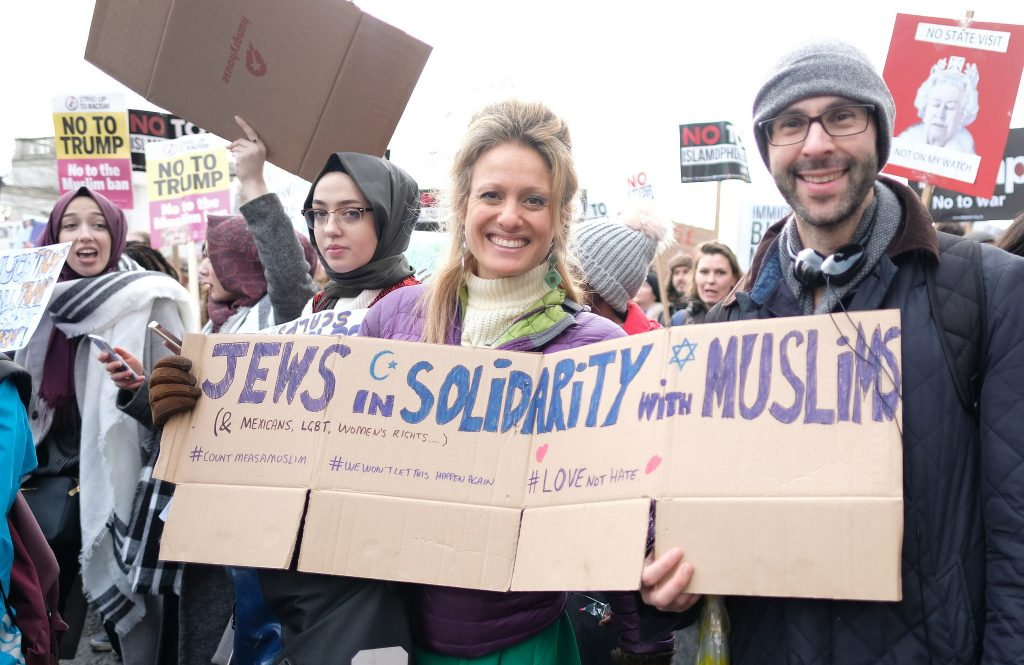 People holding Muslim solidarity sign