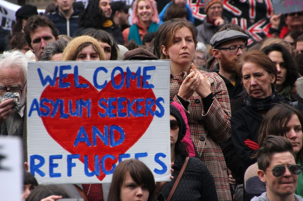 Welcome asylum seekers sign