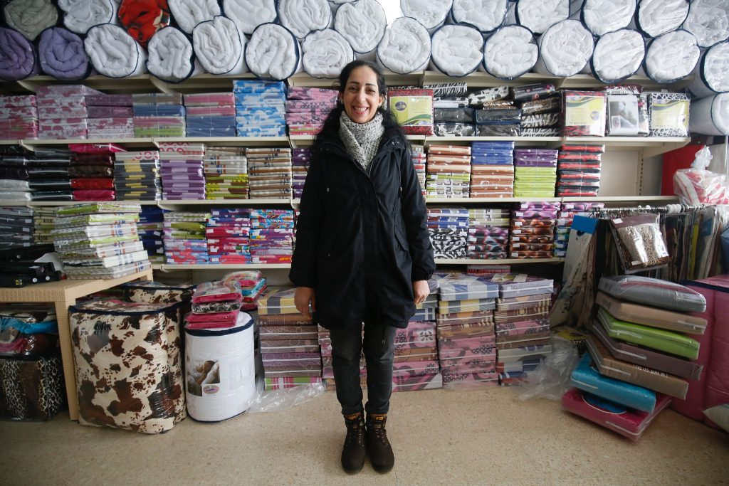 Sawsan, a Syrian refugee from Damascus, who is now working as an accountant in a textile manufacturing business in Lebanon.