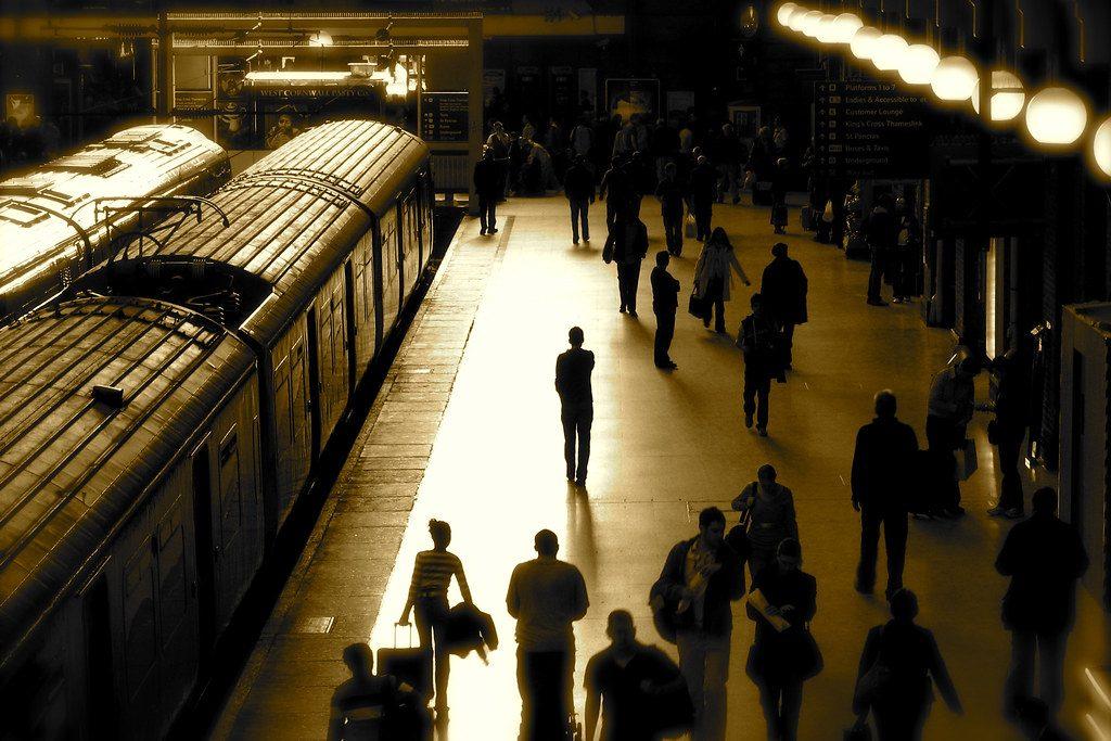 People walk along King's Cross train platform