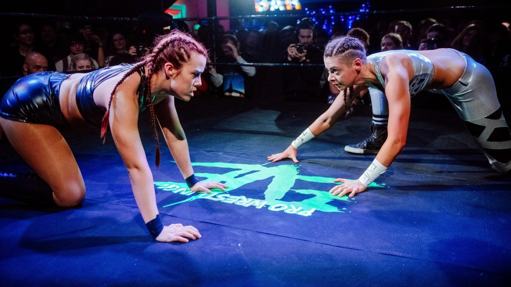 Two women wrestle