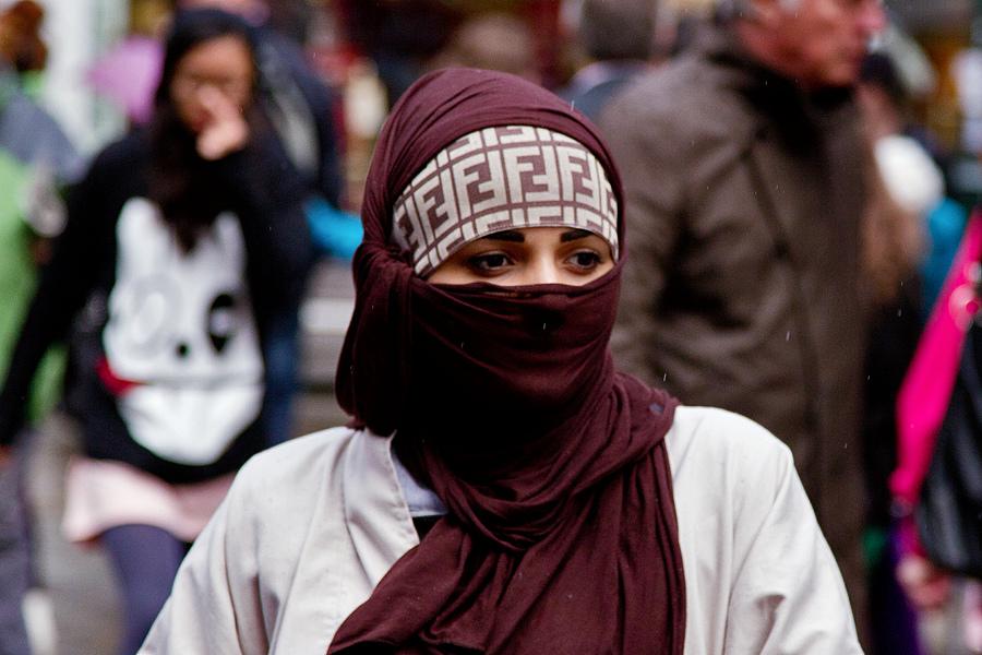 Muslim woman walks streets of London