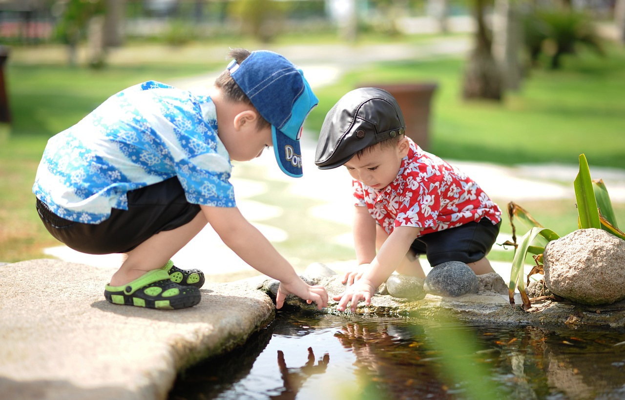 Children playing in a creek.