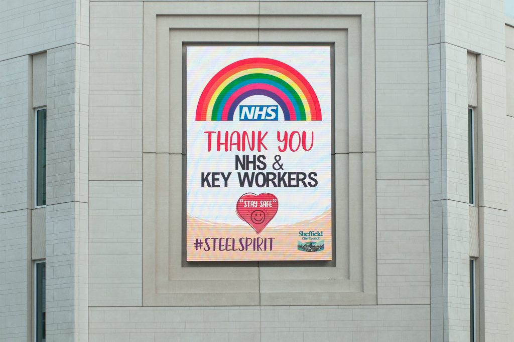 A poster showing a rainbow in support of NHS workers, including doctors, during the coronavirus pandemic