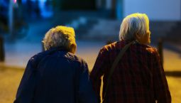 Two elder women crossing a road