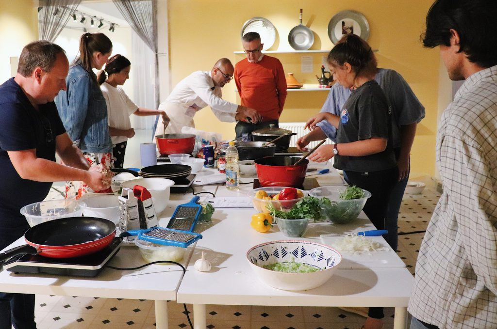 Refugee Hadi leading a cookery class