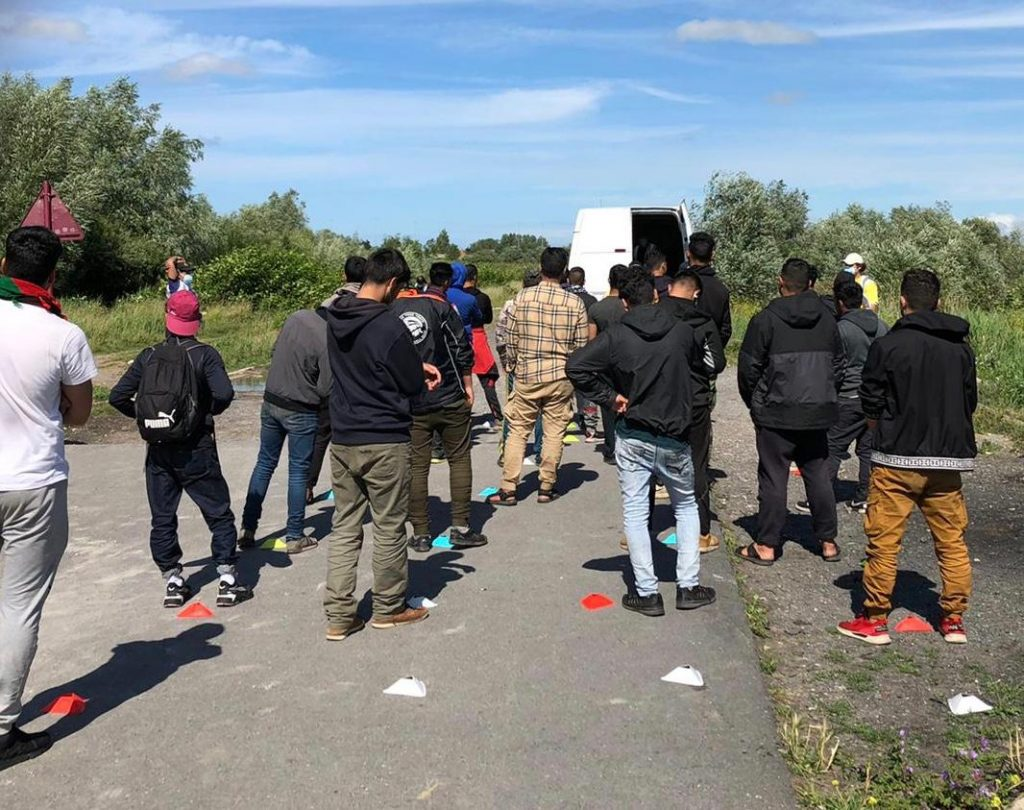 A shot of refugees in Calais during the Covid-19 crisis