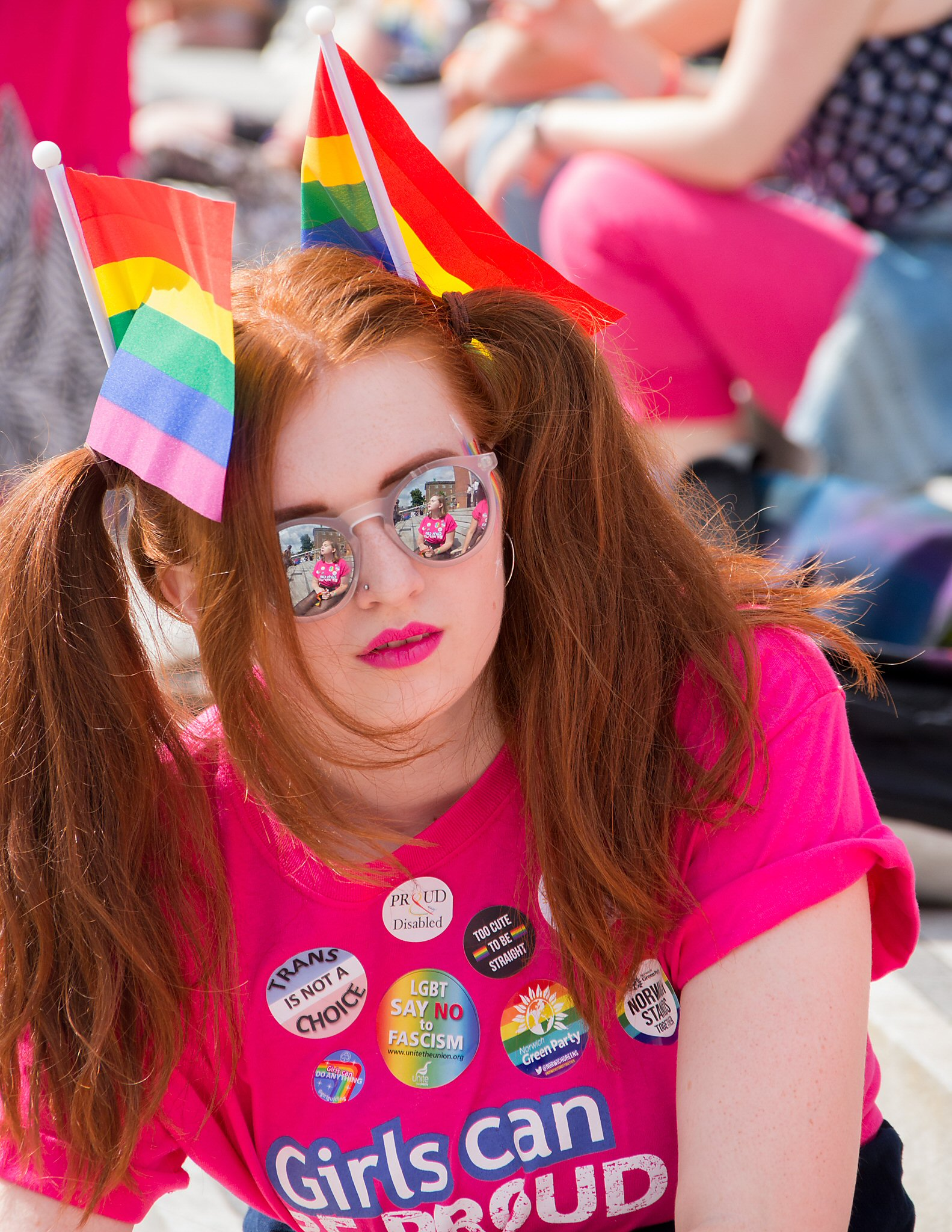 A woman with rainbow flags in her hair.