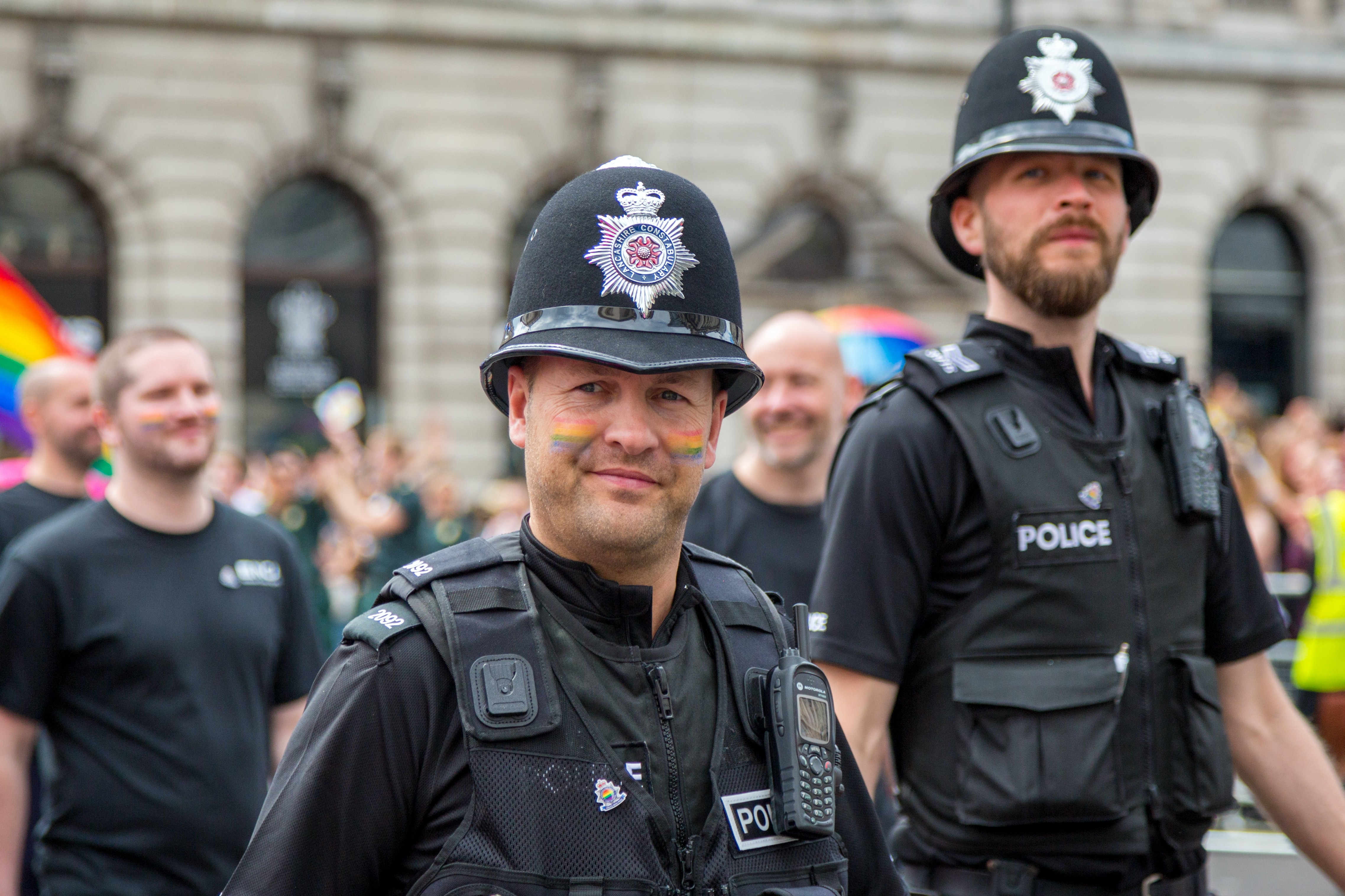 two police people look on during a pride march