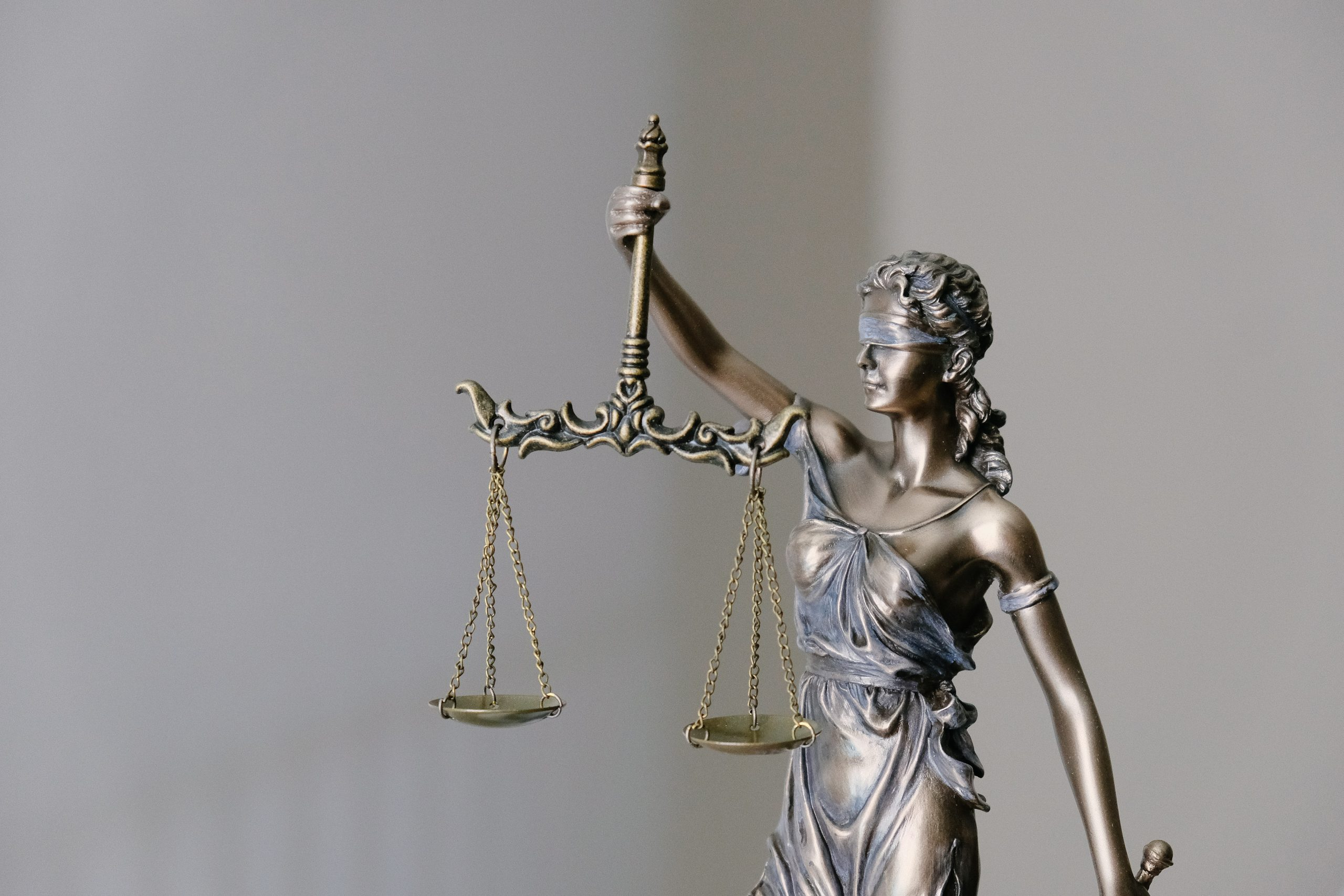 A statue of the lady of justice, holding the scales
