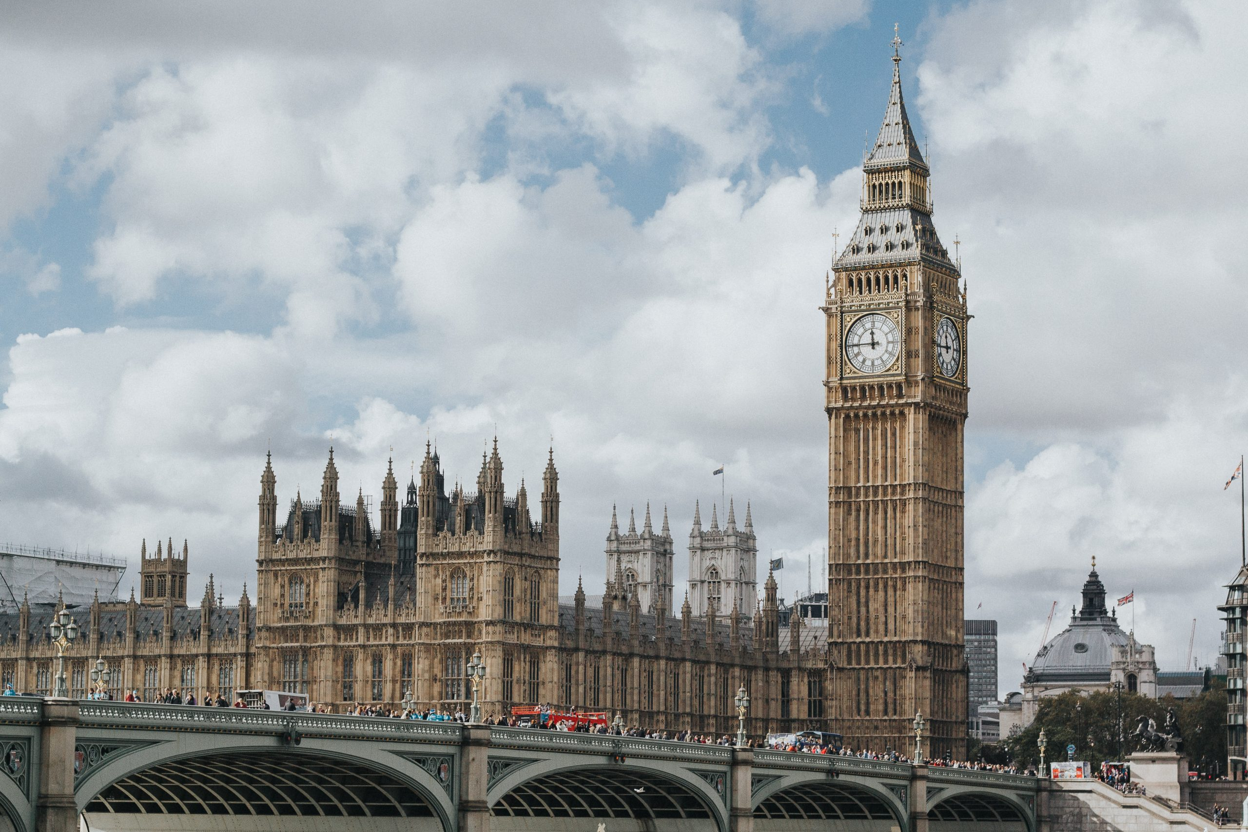 A landscape shot on a cloudy day shows Big Ben and the House of Commons